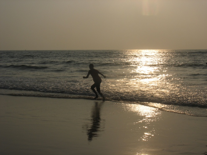 shot of a person running along the beach